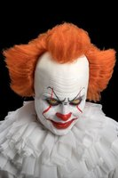 Duivelse clownspruik kaalkop met oranje haar